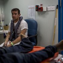 Doctor Alberto, moments after calling the death of an Eritrean man. 20 minutes of CPR, multiple discharges from a defibrillator and multiple shots of adrenaline didn't bring him back. 2016 was a deadly year of migrants and refugees trying to cross the mediterranean from Libya's coasts to Italy's. With ever increasing numbers of unseaworthy boats attempting the crossing, charities and NGOs like MOAS are often overwhelmed. MOAS, together with medicals teams from the red cross, operates two rescue vessels, the Responder and the Phoenix, just off the coast of Libya. They sit in international waters and await either the distress call from migrants lucky enough to have been given a satellite phone by their smuggler, or to visually find migrants boats - often in the dead of night. Then the race to rescue them before it too late starts.