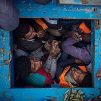 Migrants are seen inside the hold of a large wooden boat where over 500 people, mostly Eritreans and East Africans, were attempting to cross the mediterranean sea 2016 was a deadly year of migrants and refugees trying to cross the mediterranean from Libya's coasts to Italy's. With ever increasing numbers of unseaworthy boats attempting the crossing, charities and NGOs like MOAS are often overwhelmed. MOAS, together with medicals teams from the red cross, operates two rescue vessels, the Responder and the Phoenix, just off the coast of Libya. They sit in international waters and await either the distress call from migrants lucky enough to have been given a satellite phone by their smuggler, or to visually find migrants boats - often in the dead of night. Then the race to rescue them before it too late starts. © Mathieu Willcocks/MOAS.eu 2016, all rights reserved.