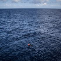 The body of a migrant found floating at sea. The unidentified man was found with a rescue organisation's life jacket on, meaning he most probably was lost at sea during his rescue. From decomposition signs, the Red Cross doctor on board estimated that he had been at sea for at least 4 days. 2016 was a deadly year of migrants and refugees trying to cross the mediterranean from Libya's coasts to Italy's. With ever increasing numbers of unseaworthy boats attempting the crossing, charities and NGOs like MOAS are often overwhelmed. MOAS, together with medicals teams from the red cross, operates two rescue vessels, the Responder and the Phoenix, just off the coast of Libya. They sit in international waters and await either the distress call from migrants lucky enough to have been given a satellite phone by their smuggler, or to visually find migrants boats - often in the dead of night. Then the race to rescue them before it too late starts. © Mathieu Willcocks/MOAS.eu 2016, all rights reserved.