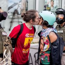 SAN JUAN, PUERTO RICO - May 1, 2017 - Carlos Farmer and Valeria Huyke kiss as their are being arrested in front of a military recruitment office during violent protests on May 1st' national strike. Protestors called for an audit of Puerto Rico's outstanding debt of more than $70 USD billion and rejected austerity measures imposed by the the Financial Oversight and Management Board for island. (photo/José E. Jiménez-Tirado)
